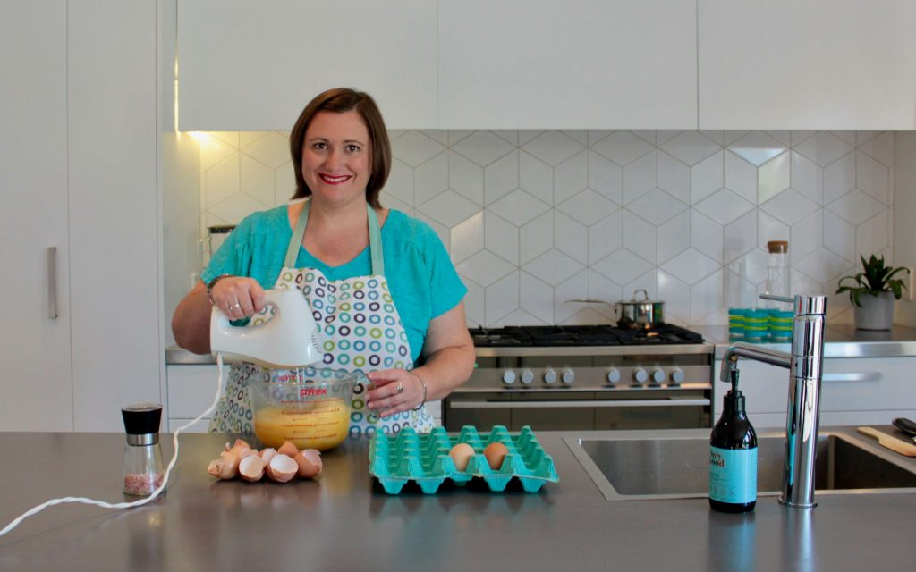Emily from Inside Out Nutrition cooking a quiche